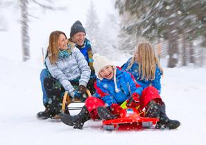 family sledding in winter