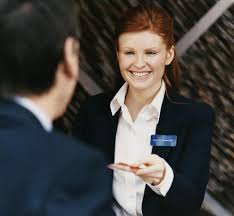 See that smile?  Proof that handing over room keys makes front desk clerks happy!